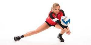 volleyball player posing in front of a plain white background setting up to bump the ball with her forearms