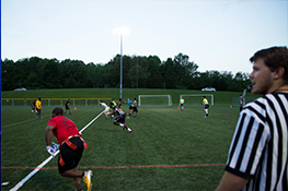 students on a field playing flag football