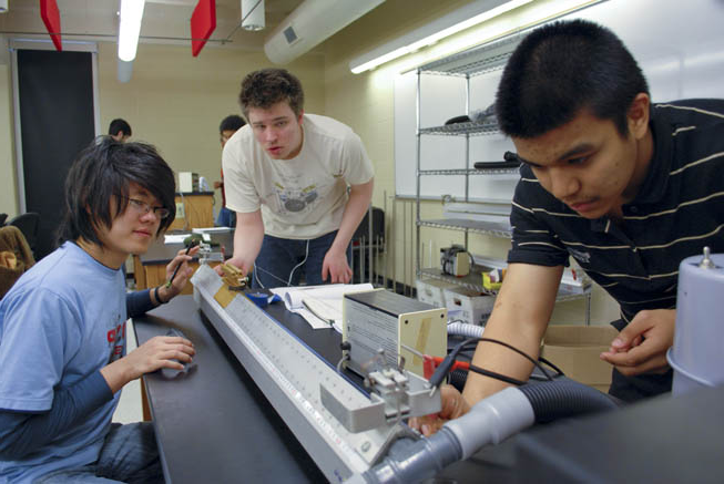 students working on physics experiment