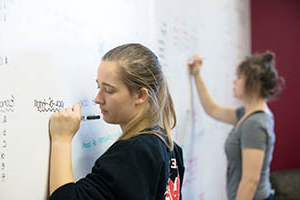 students working at whiteboard